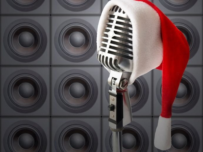 (Retro Mic In Santa Hat In Front Of Speakers Wall)